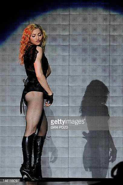 US singer Madonna performs during her Sticky Sweet Tour concert on July 23 2009 at the Vicente Calderon stadium in Madrid AFP PHOTO / DANI POZO