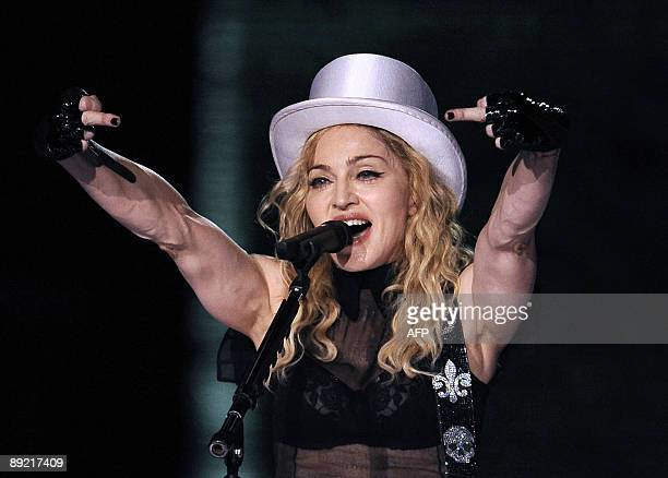 """Singer Madonna performs during her """"Sticky & Sweet Tour"""" concert on July 23, 2009 at the Vicente Calderon stadium in Madrid. AFP PHOTO / DANI POZO"""