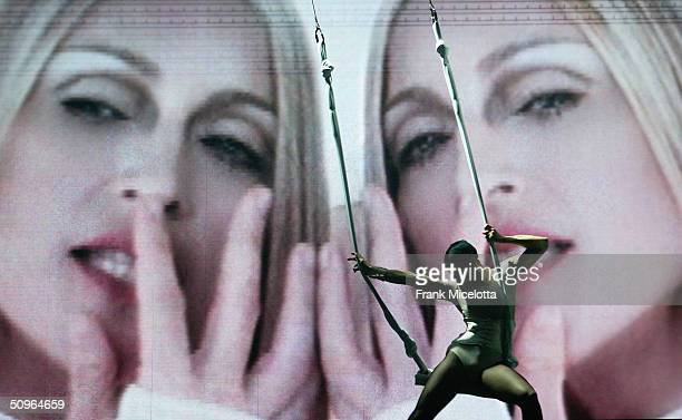 Singer Madonna performs during the final dress rehearsal for the ReInvention World Tour 2004 at The Great Western Forum May 21 2004 in Inglewood...