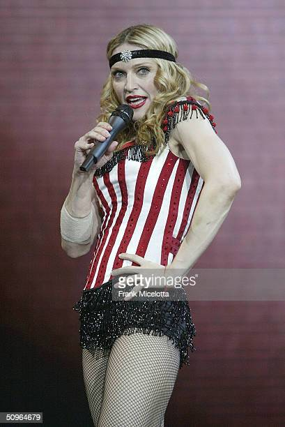 "Singer Madonna performs during the final dress rehearsal for the ""Re-Invention"" World Tour 2004 at The Great Western Forum, May 21, 2004 in..."
