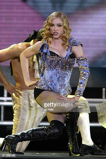 Singer Madonna performs on stage during the first London date of the UK leg of her 'ReInvention' World Tour 2004 at Earls Court August 18 2004 in...