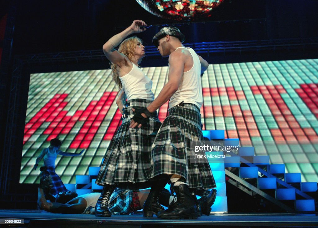 Singer Madonna performs onstage during her 'Re-Invention' World Tour 2004 at the Arrowhead Pond, June 2, 2004 in Anaheim, California.