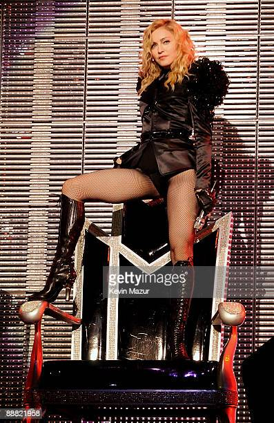 Singer Madonna performs onstage during the opening night of her Sticky and Sweet tour at the O2 Arena on July 4 2009 in London England