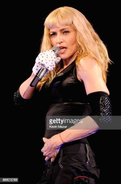 """Singer Madonna performs onstage during the opening night of her """"Sticky and Sweet"""" tour at the O2 Arena on July 4, 2009 in London, England."""