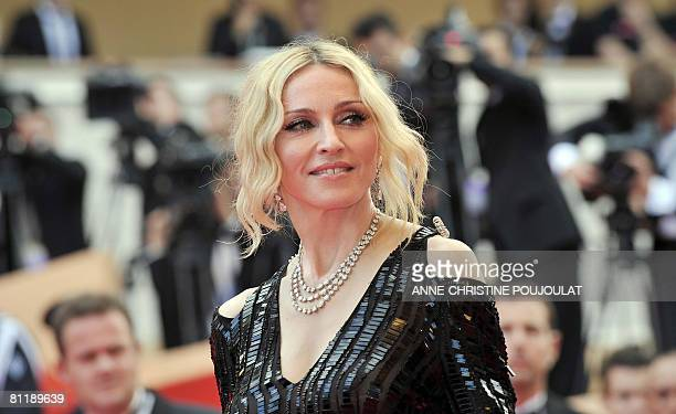 US singer Madonna poses as she arrives to attend the screening of Nathan Rissman's documentary film 'I Am Beacuse We Are' at the 61st Cannes...