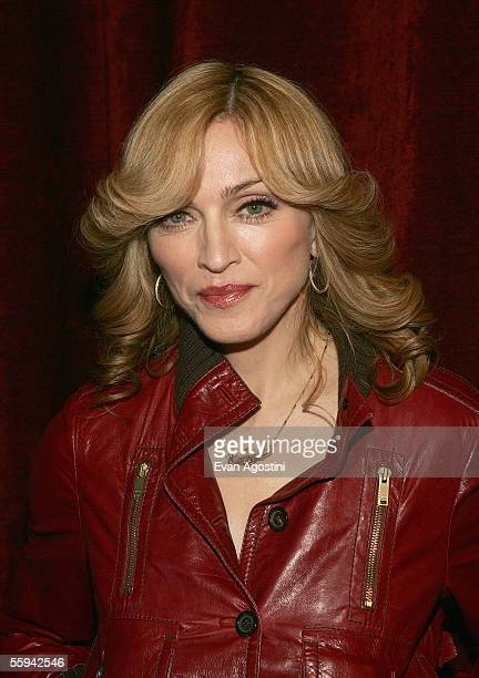 Singer Madonna poses for a photo backstage during MTV's Total Request Live at the MTV Times Square Studios on October 17 2005 in New York City