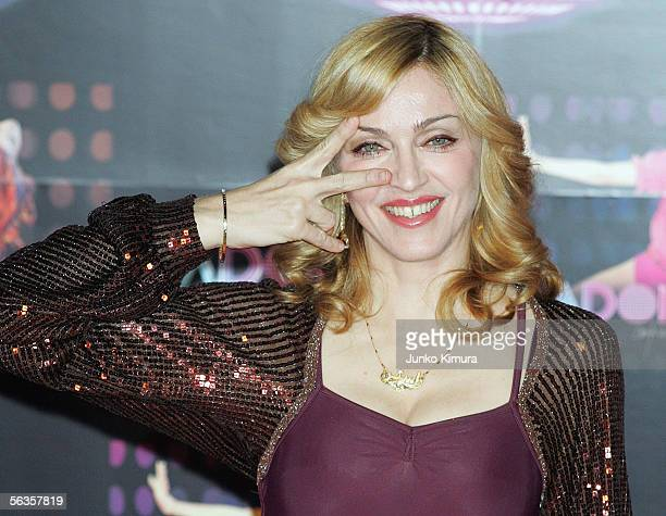 Singer Madonna poses for photographers during a press conference on December 7 2005 in Tokyo Japan She is in Japan to promote her new album...