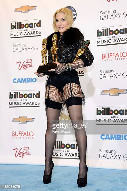 Singer Madonna poses with awards in the press room during the 2013 Billboard Music Awards at the MGM Grand Garden Arena on May 19 2013 in Las Vegas...