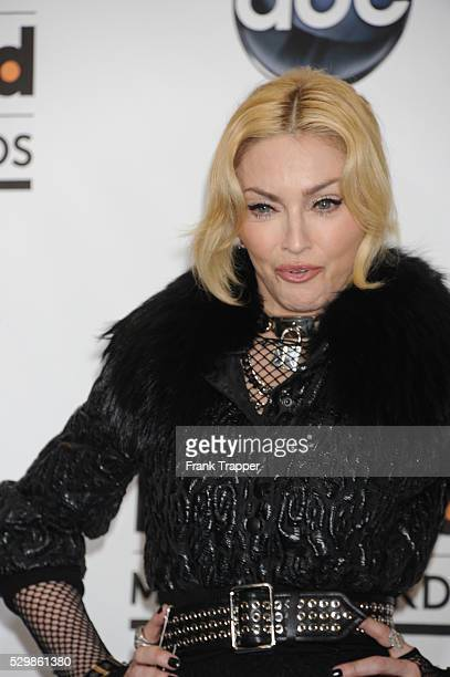 Singer Madonna posing with the Top Touring Artist Award at the 2013 Billboard Music Awards held at the MGM Grand Garden Arena in Las Vegas Nevada
