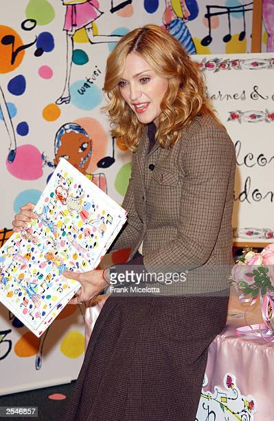 "Singer Madonna reads her best selling children's book ""The English Roses"" to children at the Barnes & Noble store in Rockefeller Center in New City..."
