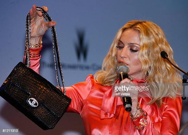 Singer Madonna speaks during amfAR's Cinema Against AIDS 2008 auction held at Le Moulin de Mougins during the 61st International Cannes Film Festival...