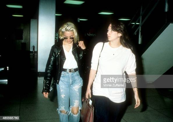https://media.gettyimages.com/photos/singer-madonna-walks-with-her-assistant-melissa-crowe-at-the-jfk-picture-id485565780?s=594x594
