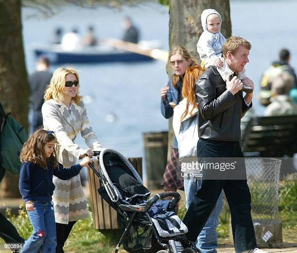 Singer Madonna walks with her husband producer Guy Ritchie daughter Lourdes and son Rocco during an outing in Hyde Park April 21 2002 in London...