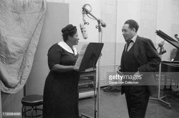 Singer Mahalia Jackson and composer and bandleader Duke Ellington in the Columbia Records studio recording the album 'Black, Brown and Beige' in...