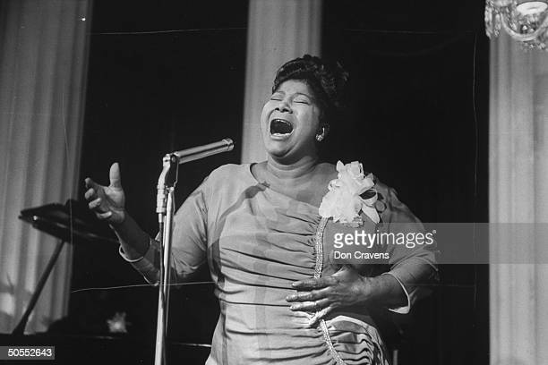 Singer Mahalia Jackson singing at reception in hotel