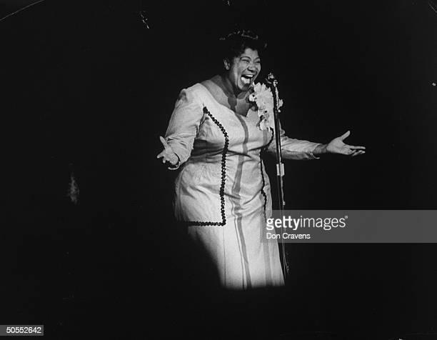 Singer Mahalia Jackson singing at Shrine Auditorium