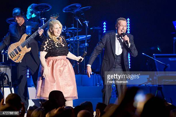 Singer Maite Kelly and Roland Kaiser perform during a concert at the O2 World on May 9, 2015 in Berlin, Germany.