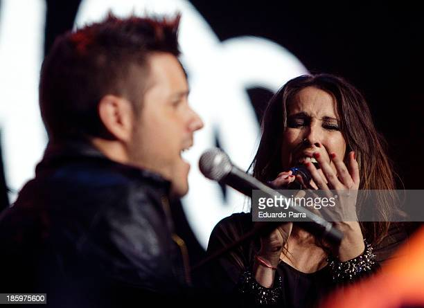 Singer Malu and singer Pablo Lopez performs live in 'Por Ellas' concert at Madrid sports palaceon October 26 2013 in Madrid Spain