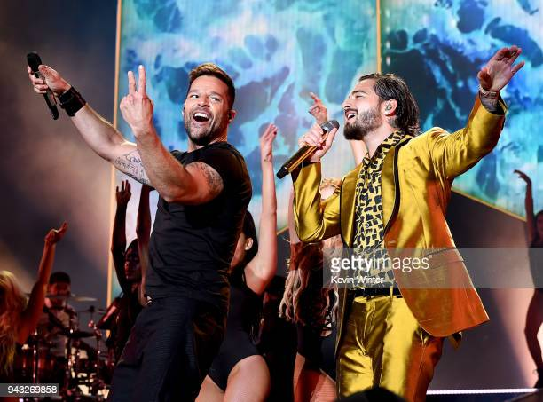 """Singer Maluma , with singer Ricky Martin , performs during his """"F.A.M.E. Tour"""" at The Forum on April 7, 2018 in Inglewood, California."""