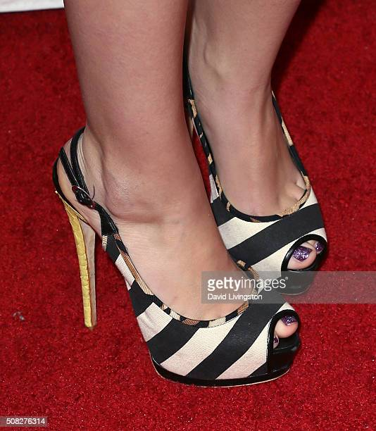 Singer Manika shoe detail attends the Miss Me and Cosmopolitan's spring campaign launch event hosted by Bella Thorne at The Terrace at Sunset Tower...