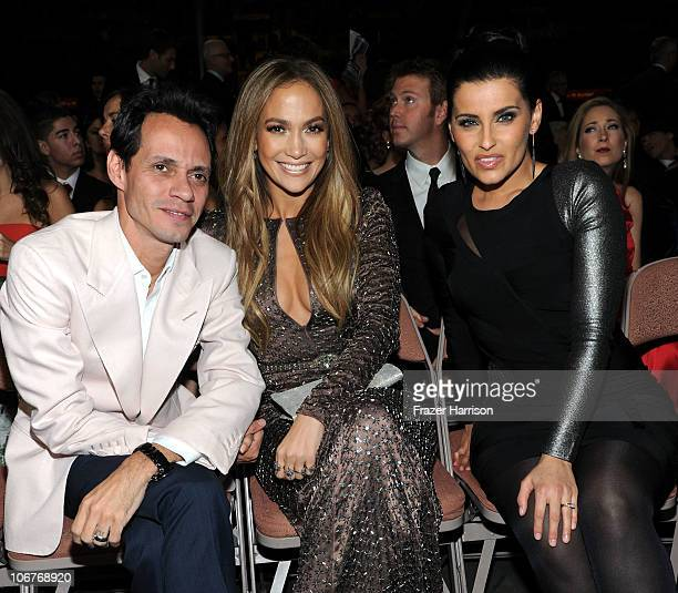 Singer Marc Anthony, actress Jennifer Lopez, and singer Nelly Furtado pose in the audience during the 11th annual Latin GRAMMY Awards at the Mandalay...