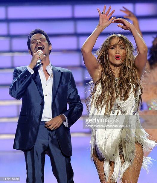 Singer Marc Anthony and singer/actress Jennifer Lopez perform onstage during Fox's 'American Idol 2011' finale results show held at Nokia Theatre LA...