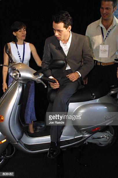 Singer Marc Anthony checks out a motor scooter given to him at the 12th Annual Billboard Latin Music Conference Awards April 25 2001 in Miami Beach...