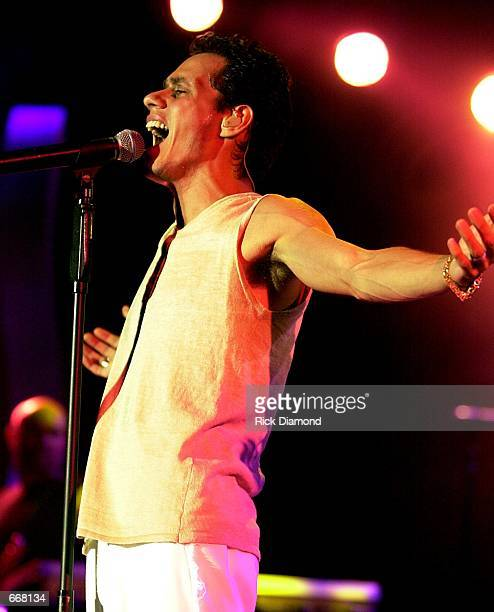Singer Marc Anthony performs during his concert July 13 2000 at Chastain Park Amphitheater in Atlanta Ga