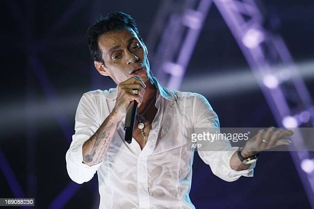 US singer Marc Anthony performs in the framework of the Salsa Festival in Boca del Rio Veracruz state Mexico on May 19 2013 AFP PHOTO/KORAL CARBALLO