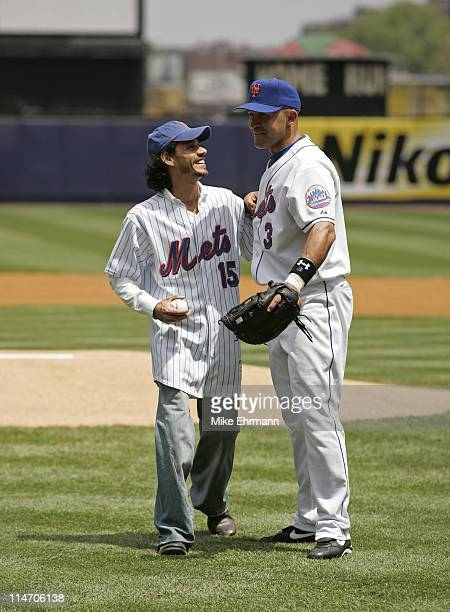 Singer Marc Anthony throws out the first pitch with Miguel Cairo before a subway series game between the New York Mets and the New York Yankees at...