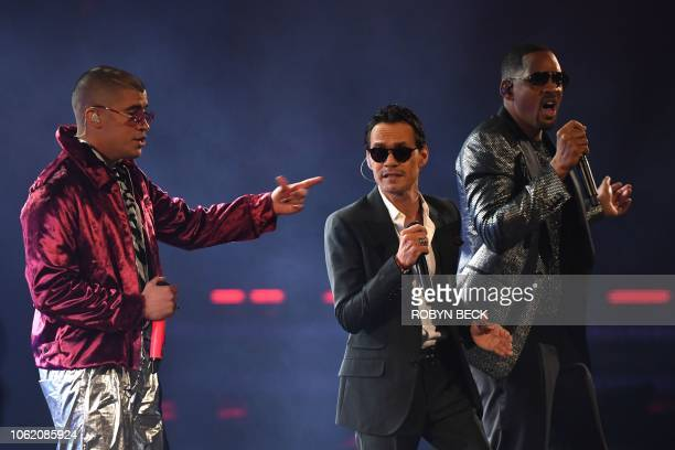 US singer Marc Anthony US actor and rapper Will Smith and Puerto Rican singer Bad Bunny perform during the 19th Annual Latin Grammy Awards in Las...
