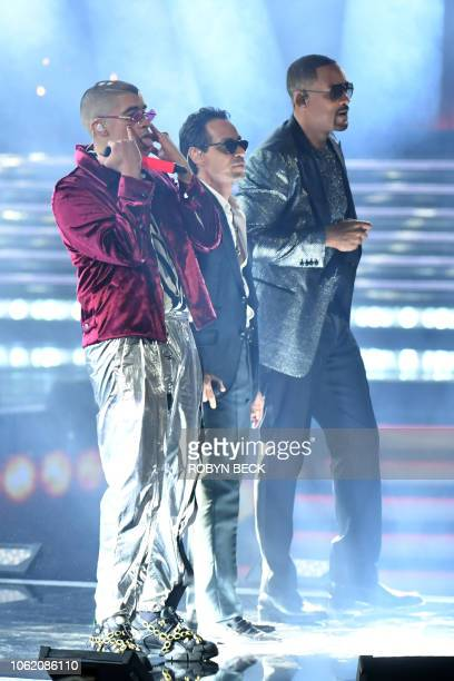 US singer Marc Anthony US actor and rapper Will Smith and Puerto Rican singer Bad Bunny perform perform during the 19th Annual Latin Grammy Awards in...