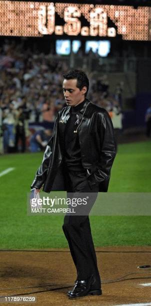 Singer Marc Anthony walks off the field after singing the National Anthem in an emotional pregame ceremony 21 September 2001 prior to the start of...