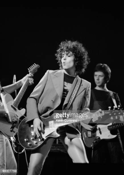 Singer Marc Bolan and bassist Herbie Flowers of T.Rex perform on stage at the Apollo in Manchester on March 11, 1977.