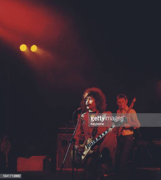 Singer Marc Bolan and guitarist Steve Currie of glam rock band T Rex perform at the Lyceum in London February 1976