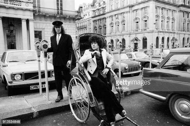 Singer Marc Bolan in a rickshaw in London Drawing the rickshaw is Alphie O'Leary Marc's chauffeur 12th December 1973