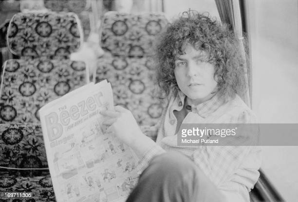 Singer Marc Bolan of English glam rock group TRex reading a copy of Beezer comic on a tour bus before a concert at Newcastle City Hall 24th June 1972