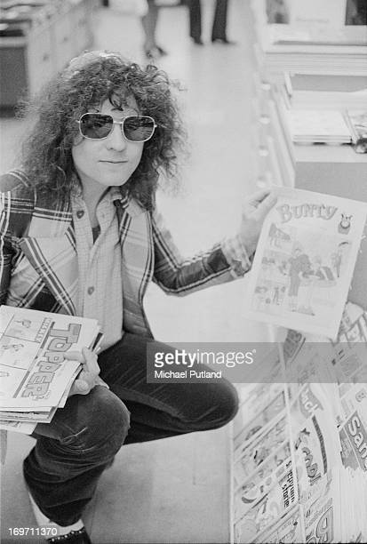 Singer Marc Bolan of English glam rock group TRex shopping for children's comics before a concert at Newcastle City Hall 24th June 1972