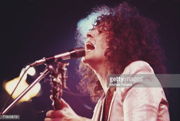 Singer Marc Bolan performing with English glam rock group T-Rex at a venue during a tour of the United Kingdom in 1972.