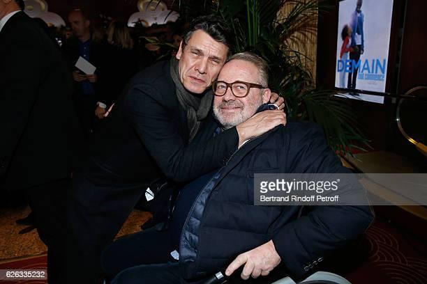 Singer Marc Lavoine and Dominique Segall attend the Demain Tout Commence Paris Premiere at Cinema Le Grand Rex on November 28 2016 in Paris France
