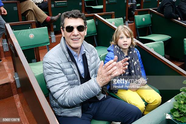 Singer Marc Lavoine and his son Roman attend Day Eleven of the 2016 French Tennis Open at Roland Garros on June 1 2016 in Paris France