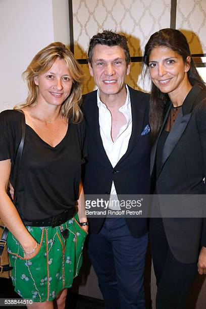 Singer Marc Lavoine standing between his wife Sarah and Hoda Roche attend the Opening of the Boutique Buccellati situated 1 Rue De La Paix in Paris...