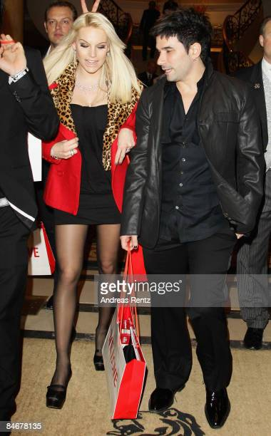 Singer Marc Terenzi and Gina Lisa Lohfink leave the 'Movie Meets Media' as part of the 59th Berlin Film Festival at the Ritz Carlton Hotel on...