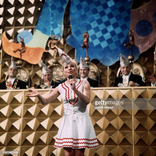 Singer Margit Sponheimer during her performance at the 'Mainz wie es singt und lacht' carnival event in 1970 In the background members of the...