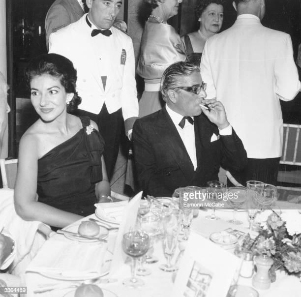 Singer Maria Callas dining with Greek born Argentinian financier, Aristotle Onassis .
