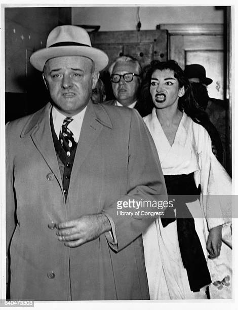 Singer Maria Callas dressed in a white costume shouts angrily at US Marshal Stanley Pringle backstage after a performance of Madame Butterfly at the...