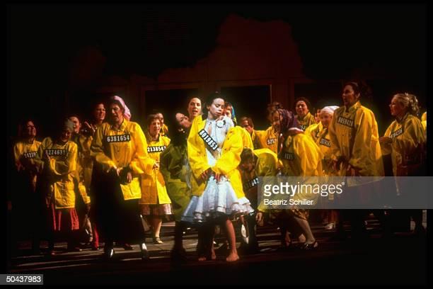 Singer Maria Ewing w chorus of female convicts in yellow jackets in scene fr Metropolitan Opera premiere of Dmitri Shostakovich's Lady Macbeth of...