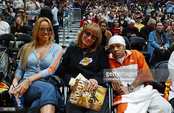 Singer Mariah Carey actress/director Penny Marshall and rap artist Lil' Bow Wow attend the game between the Los Angeles Lakers and the Indiana Pacers...