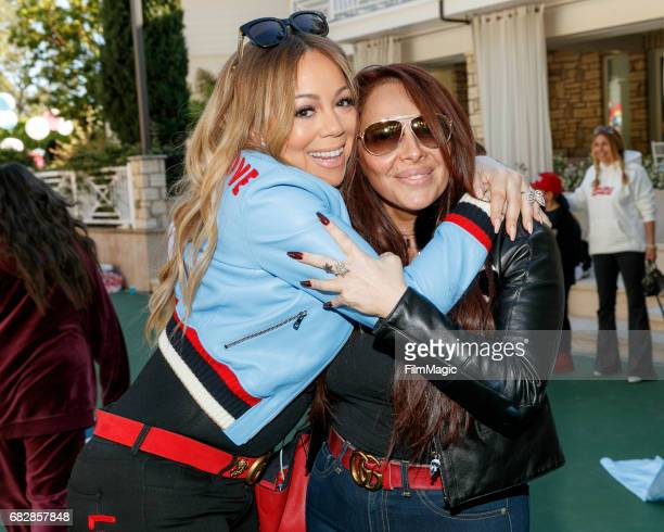 Singer Mariah Carey and a guest attend the Moroccan Scott Cannon and Monroe Cannon Party on Mary 13 in Los Angeles California