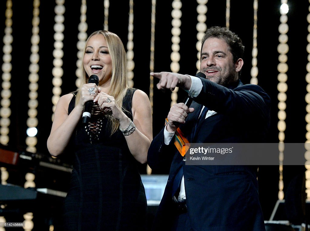 Singer Mariah Carey (L) and honoree Brett Ratner speak onstage during the Venice Family Clinic Silver Circle Gala 2016 honoring Brett Ratner and Bill Flumenbaum at The Beverly Hilton Hotel on March 7, 2016 in Beverly Hills, California.